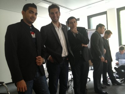 Mansoor, Eduardo, and Daniel in class, getting tips about their suits
