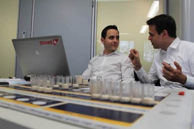 Remo (l.) and Dominic discussing the next steps during an aviation business game